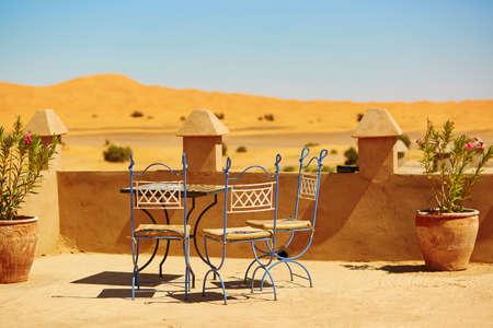 arabic desert: Table of a cafe in Merzouga village in Sahara desert, Morocco