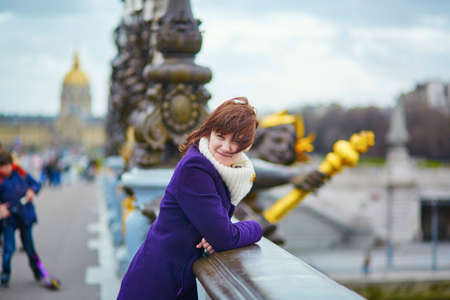 alexandre: Beautiful young tourist in Paris on the Pont Alexandre III Stock Photo