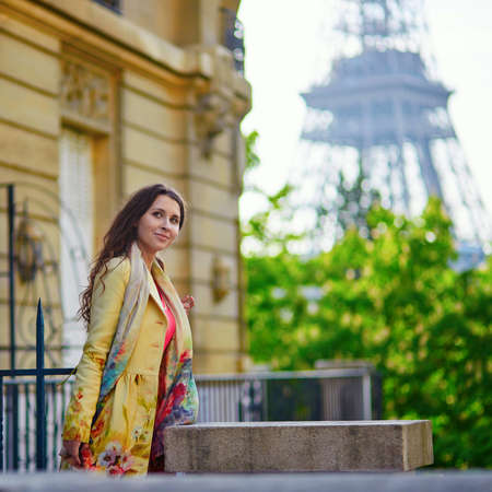 french model: Beautiful young woman on a street near the Eiffel tower in Paris
