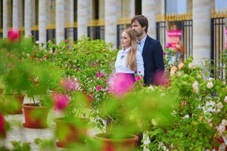 palais: Beautiful romantic couple having a date in Palais Royal in Paris