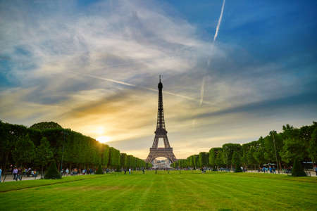 eiffel tower architecture: Scenic view of the Eiffel tower in Paris during sunset on a summer evening