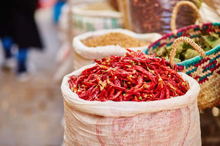 chili: Selection of chili peppers on a traditional Moroccan market (souk) in Fes, Morocco