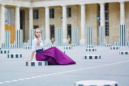 palais: Beautiful young woman in Palais Royal in Paris Stock Photo