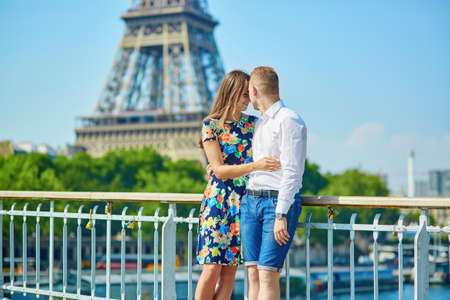 hot boy: Romantic couple having a date near the Eiffel tower in Paris Stock Photo