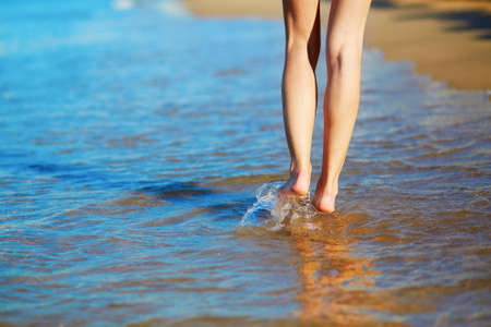hot girl legs: Closeup of legs of a woman walking on the beach