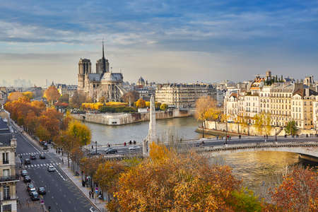 Scenic view of Notre-Dame de Paris with Saint-Louis and Cite islands on a bright fall day