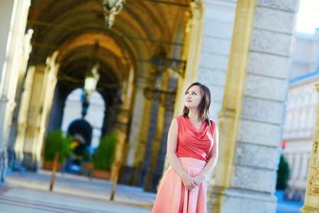 rathaus: Beautiful young woman walking near the town hall (Rathaus) in Vienna, Austria