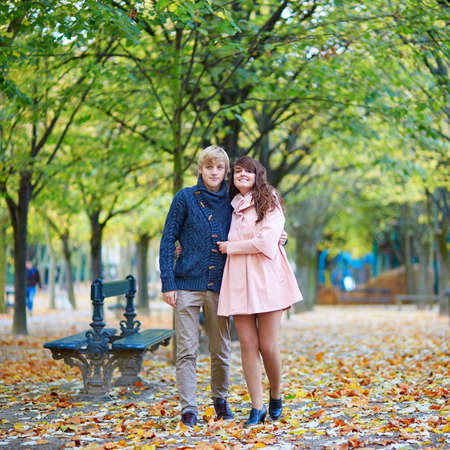 romantic couple: Young romantic couple in Paris, enjoying beautiful autumn day Stock Photo