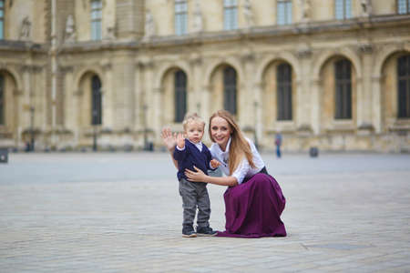 palais: Beautiful young mother and her adorable toddler son having fun together in Palais Royal in Paris Stock Photo