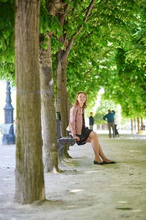 palais: Beautiful Parisian woman in Palais Royal garden