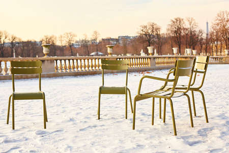jardin de luxembourg: Rare snowy day in Paris. Lots of snow and chairs in the Luxembourg Garden Stock Photo