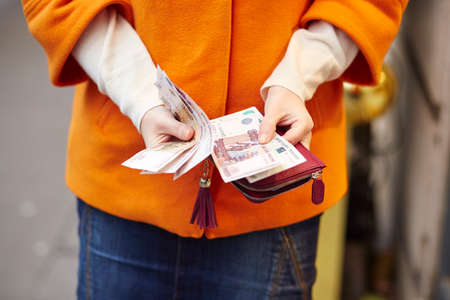 roubles: Woman hands holding purse with Russian roubles, financial crisis in Russia concept