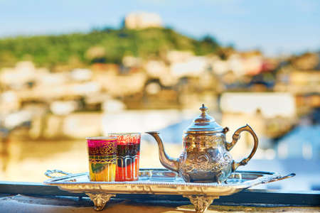 tea kettle: Traditional Moroccan mint tea with sweets