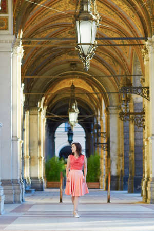 rathaus: Beautiful young tourist walking in the street near the Rathaus (city hall) in Vienna, Austria