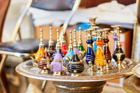 perfume: Selection of traditional bottle for perfumes or incenses on Moroccan market (souk) in Fes, Morocco Stock Photo