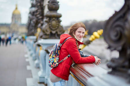 iii: Beautiful young tourist in Paris on the Pont Alexandre III Stock Photo