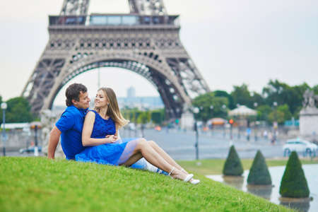 couple dating: Beautiful young dating couple in Paris near the Eiffel tower