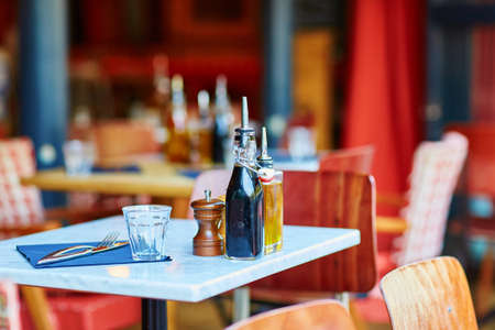french cafe: Tables of traditional outdoor French cafe in Paris