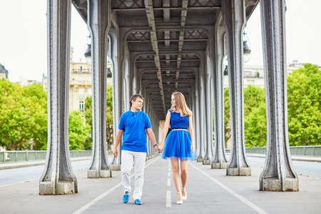 bir: Beautiful young dating couple in Paris on Bir Hakeim bridge