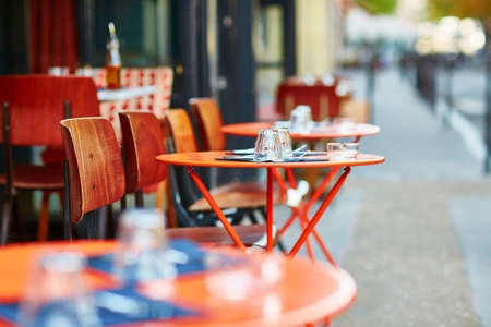 french: Tables of traditional outdoor French cafe in Paris
