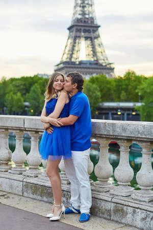 bir: Beautiful young dating couple in Paris on Bir Hakeim bridge near the Eiffel tower at sunrise Stock Photo