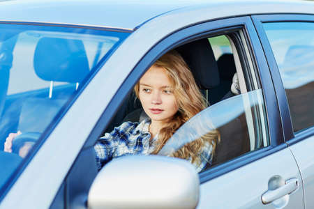 driving: Beautiful young confident woman driving a car Stock Photo