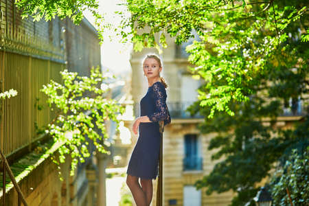 pretty lady: Beautiful young woman on a street of Paris on a sunny fall or spring day