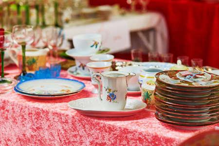 fleamarket: Antique plates and pitcher Parisian on flea market Stock Photo