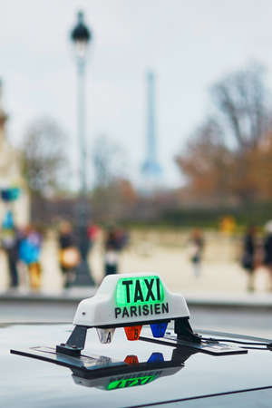taxi sign: Green taxi sign in Paris, France Stock Photo