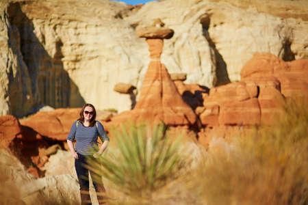hoodoo: Female tourist under giant hoodoo formation in Arizona, USA Stock Photo