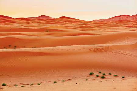 merzouga: Sunrise in sand dunes in the Sahara Desert, Merzouga, Morocco Stock Photo