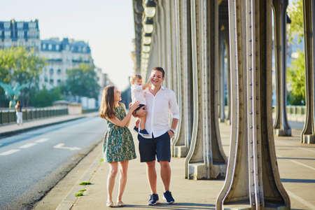 bir: Happy family of three enjoying their vacation in Paris, France