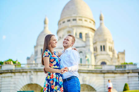 relationship love: Romantic couple kissing near Sacre-Coeur cathedral on Montmartre, Paris Stock Photo