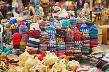 Selection of woolen hats on a traditional Moroccan market (souk) in Marrakech, Morocco
