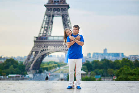 trocadero: Romantic dating couple on Trocadero viewpoint in Paris, hugging, Eiffel tower is in the background Stock Photo
