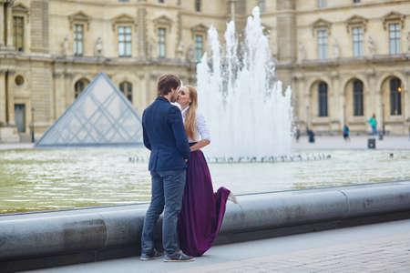 romantic date: Beautiful romantic couple having a date in Palais Royal in Paris