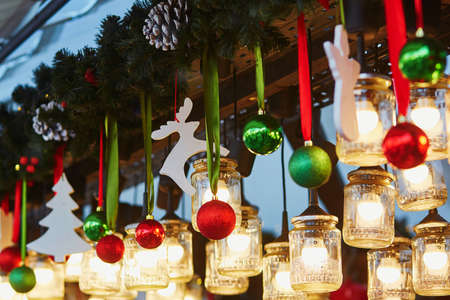 colorful christmas decorations and glass lanterns on a parisian christmas market stock photo 50388820 - Colorful Christmas Decorations