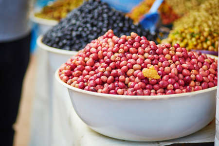 souk: Selection of pickled olives on a traditional Moroccan market (souk) in Essaouira, Morocco