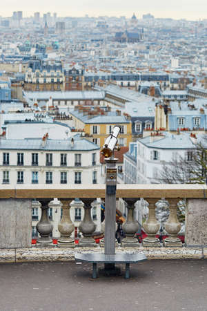 touristic: Touristic telescope overlooking Montmartre hill with scenic city view in Paris, France