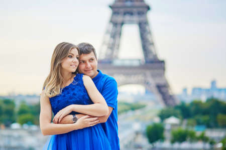 couple dating: Romantic dating couple on Trocadero viewpoint in Paris, hugging, Eiffel tower is in the background Stock Photo