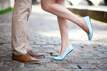 leather shoes: Male and female legs during a romantic date Stock Photo