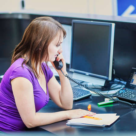 secretary phone: Business, communication and call center concept - beautiful young receptionist at work