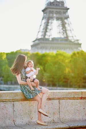 bir: Beautiful young mother with her adorable little son on the Bir Hakeim bridge in Paris, France