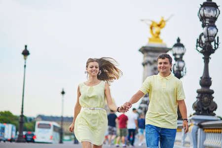 alexandre: Romantic dating couple of tourist in Paris, on the famous Alexandre III bridge over the Seine