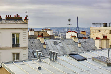 Scenic view of Parisian roofs and Eiffel tower from Montmartre, focus on the Eiffel tower