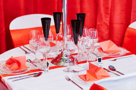 candleholder: Beautiful table set with candles and flowers for a festive event, party or wedding reception, in red color