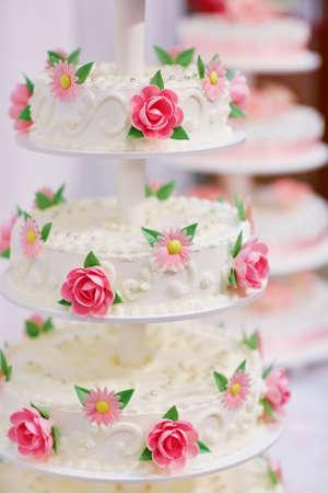 White wedding cake decorated with sugar flowers pink roses stock photo white wedding cake decorated with sugar flowers pink roses and daisies mightylinksfo
