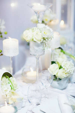 Beautiful table set with candles and flowers for a festive event, party or wedding reception