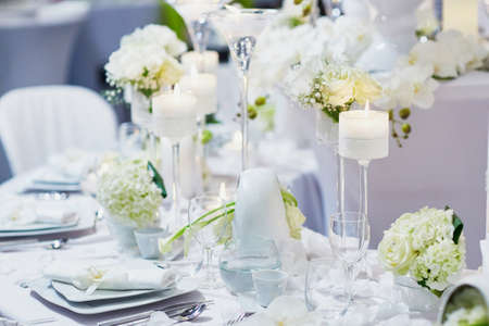 Beautiful table set with candles and flowers for a festive event, party or wedding reception Zdjęcie Seryjne - 52920120