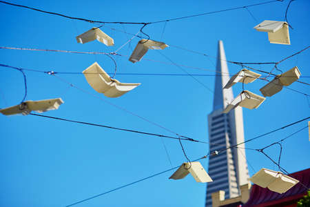 frisco: Flying books over blue sky in San Francisco, California, USA Stock Photo